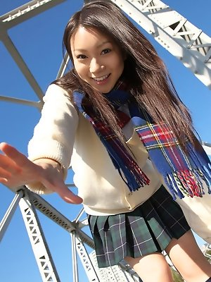 Tomoyo Hoshino Asian in short skirt goes to a walk in the city
