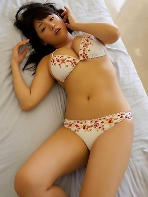 Ai Nanase looking very cute in her flower print bikini