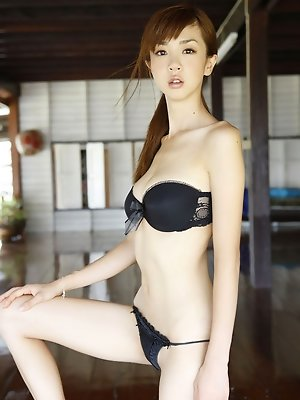Incredibly gorgeous asian babe allures in her skimpy bikini