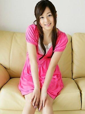 Beautiful gravure idol is adorable in cute little pink dress